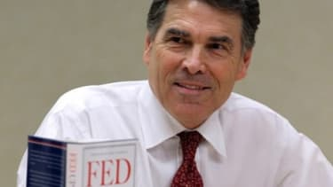Texas Gov. Rick Perry at a book signing in June 2011: The GOP presidential candidate may be stepping back from his firry criticism of federal social security system.
