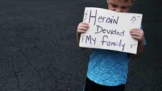 An Ohio child holds a heartbreaking sign.