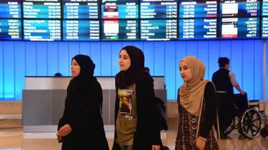 Travelers arrive at Los Angeles International Airport.