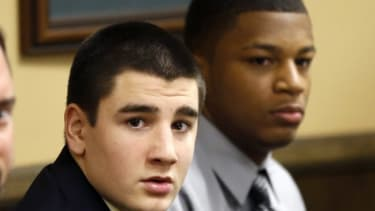 Trent Mays, 17, left, and Ma'lik Richmond, 16, sit at the defense table before the start of their trial on March 13.