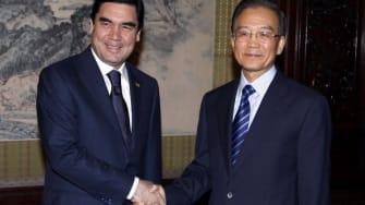 Kurbanguly Berdymukhamedov, left, and Wen Jiabao.