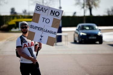 Fan protesting the formation of a European football Super League.