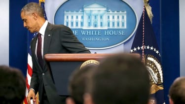 President Obama leaves the podium after his ninth press conference after a mass shooting
