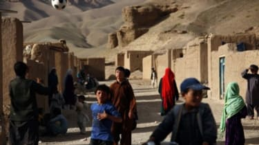 Children play outside their homes in central Afghanistan: In February 2010, the U.S. military accidentally killed more than a dozen civilians, including two children.