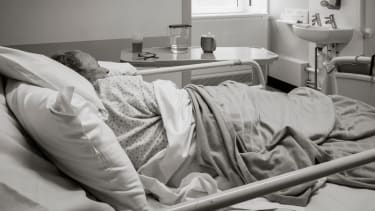 An elderly British hospital patient.