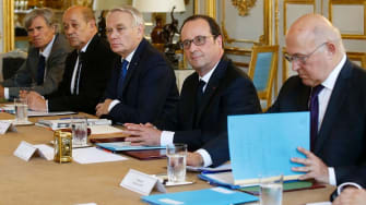 French President Francois Hollande and several French ministers.