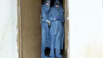 Health officials treat ebola patients in Nigeria.