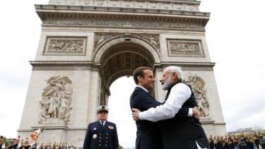 Indian Prime Minister Narendra Modi hugs French President Emmanuel Macron