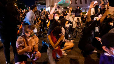 Protesters in D.C. brace themselves under military helicopters
