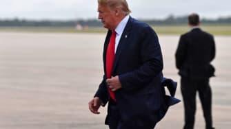 Trump walks against the wind