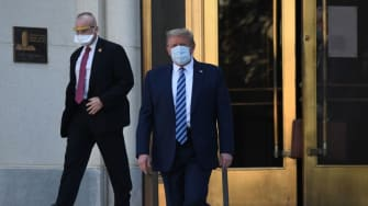 Donald Trump walks out of Walter Reed.
