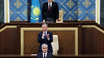 Kazakhstan's new president (bottom) and old president (top) at inauguration