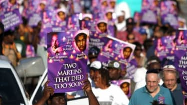 Demonstrators march to commemorate the death of Trayvon Martin
