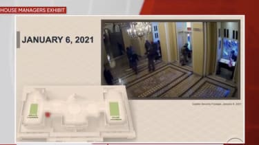 Security footage of rioters break into the Capitol.