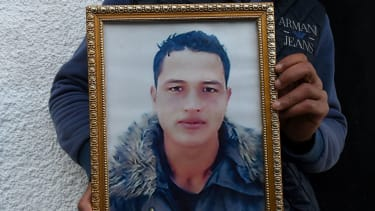 Anis Amri's brother holds his portrait
