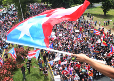Puerto Ricans celebrate the resignation of their governor.