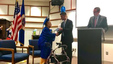 Esther Begam receives her high school diploma.