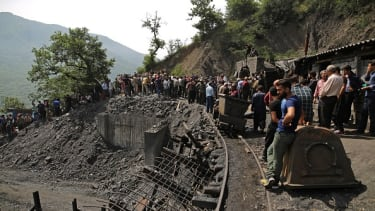 Miners and rescue workers at the mine that collapsed in Iran on Wednesday.