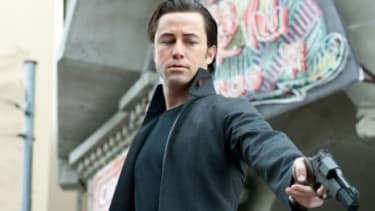 Many critics are comparing Looper to Inception, which both star Joseph Gordon-Levitt and feature action-packed, mind-bending narratives.