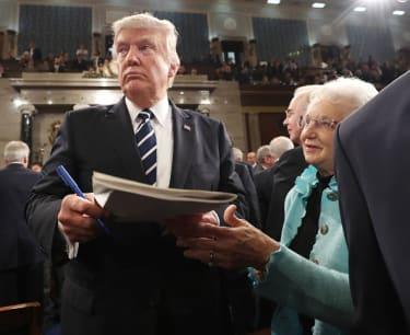 Trump signs an autograph.