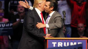 Donald Trump Jr. hugs his father at a campaign event