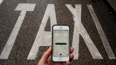 Uber starts charging a $2 fee for hailing taxis