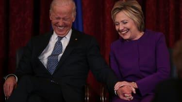 Clinton and Biden share a laugh.