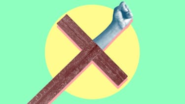 A fist and a cross.