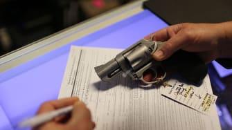 A man fills out paperwork for gun.