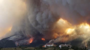 The Waldo Canyon wildfire in Colorado burns as it moves into subdivisions and destroys homes on June 26: Some Americans are drawing a direct line from global warming to this massive fire.