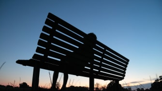 A child alone on a bench.