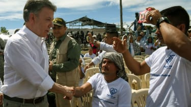Colombian President Santos meets with former FARC rebels before demilitarization ceremony