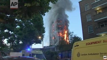 Fire engulfs the Grenell Tower apartment building in London