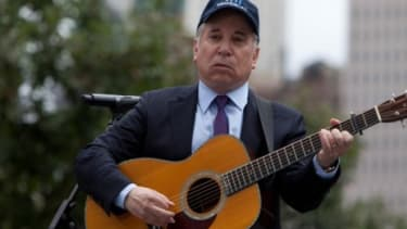 """In a somber, acoustic rendition of his 1964  classic """"The Sound of Silence,"""" Paul Simon's performance Sunday at Ground Zero was one of the weekend's most emotional 9/11 tributes"""