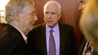 Sens. Mitch McConnell and John McCain have a quick chat.