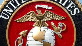 The U.S. Marine Corps seal.