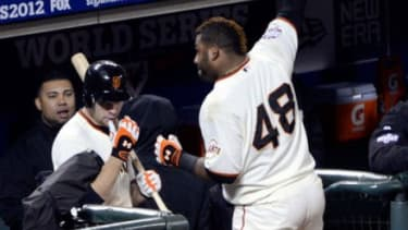 Pablo Sandoval #48 of the San Francisco Giants celebrates with a curtain call after hitting a solo home run in Game 1 of the World Series against the Detroit Tigers. Sandoval went on to hit t