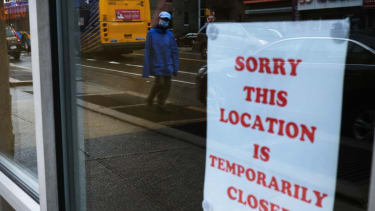 A sign alerts customers that a business is closed