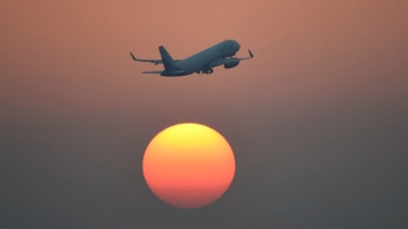 An airplane and the setting sun.