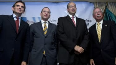 Kenneth Melson (right), the director of the Bureau of Alcohol, Tobacco, Firearms and Explosives, poses with Mexican officials last October: Melson may resign this week.