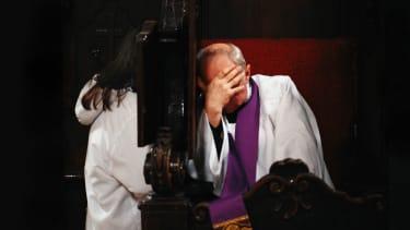 Catholic priest at confession.