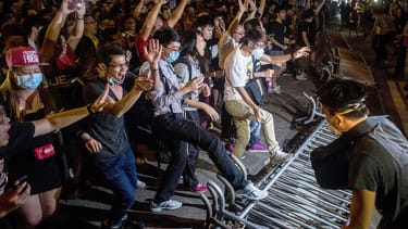Hong Kong pro-democracy protesters retake demonstration site from police