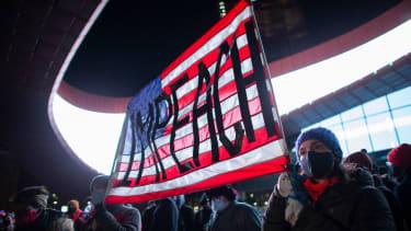 Protesters demand impeachment.