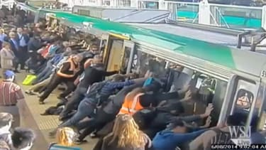 Watch these Australian commuters tip a train to save a man trapped on the platform