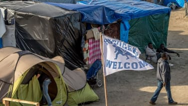 A Refugees Welcome flag in a French refugee camp.