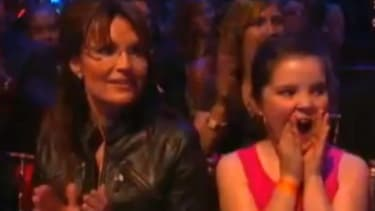 Sarah Palin and youngest daughter, Piper, weather a rowdy audience in support of Bristol's Dancing with the Stars quickstep.