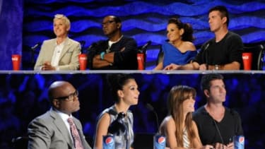 Spot the difference: Simon Cowell on his last season of American Idol in 2009 and Simon Cowell on the debut of his new singing competition show The X Factor Wednesday.