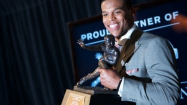 Despite an NCAA investigation into his recruitment, Auburn quarterback Cam Newton won the Heisman Trophy.