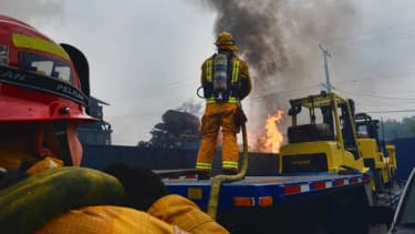 Los Angeles County Firefighters work to extinguish commercial fire at a warehouse in Maywood, Calif. on Tuesday, June 14, 2016