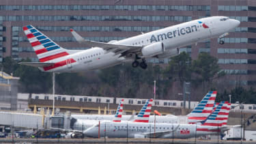 An American Airlines plane takes off.